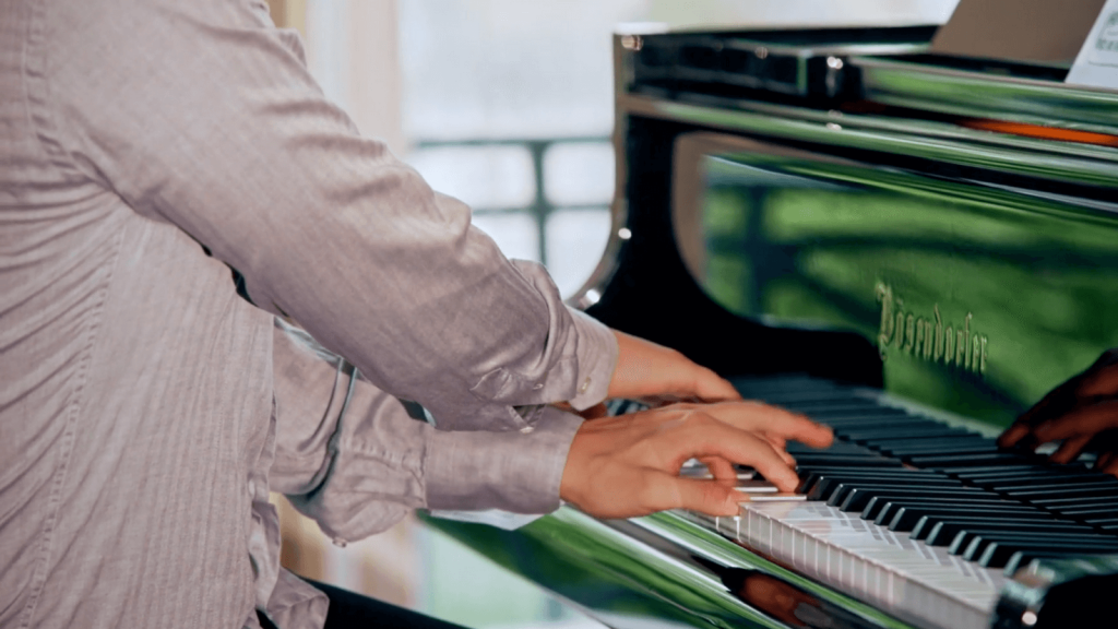 Close-up of pianist George Fu as he plays.