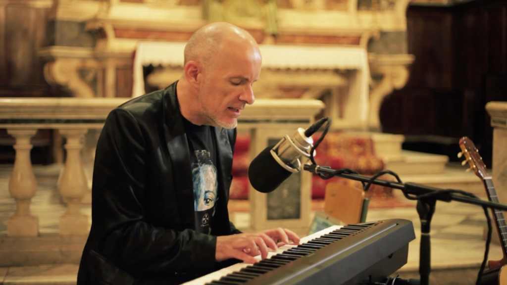 Joe Chester plays keyboard as he sings in a 17th century church in Nice, France