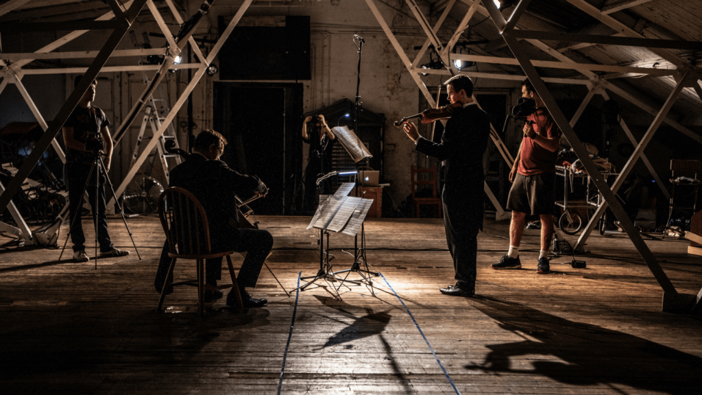 Darragh Morgan and Tim Gill play violin and cello in a warehouse space in East London.